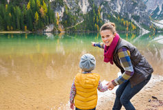 Mother and daughter playing on the shore of Lake Bries Stock Images