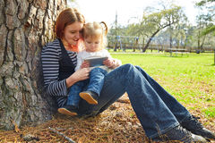 Mother and daughter playing with smartphone Stock Photography