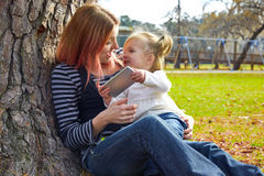 Mother and daughter playing with smartphone Royalty Free Stock Photo