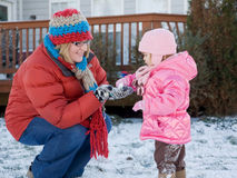 Mother and Daughter Playing in the Snow Stock Images