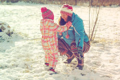 Mother and daughter playing in the snow royalty free stock photography