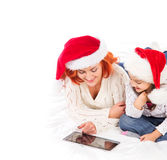 A mother and daughter playing with a tablet pc on Christmas Stock Photos