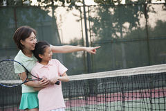 Mother and daughter playing tennis Stock Photo