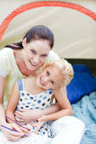 Mother and daughter playing in tent Royalty Free Stock Photography