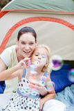 Mother and daughter playing in tent Royalty Free Stock Images