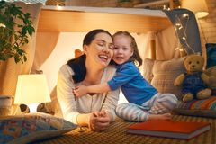 Mother and daughter playing in tent royalty free stock photos