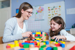 Mother and Daughter Playing Together with colorful building toy blocks Stock Photos
