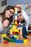 Mother and Daughter Playing Together with colorful building toy blocks Stock Image