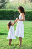 Mother and daughter are playing together. Stock Photo