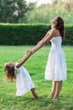 Mother and daughter are playing together. Royalty Free Stock Photos