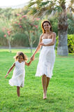 Mother and daughter are playing together. Stock Images