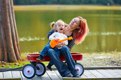 Mother and daughter playing toy guitar singing Stock Photo