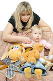 Mother and daughter playing toys Stock Photos