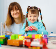 Mother and daughter playing with toys Royalty Free Stock Photos