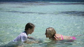 Mother and daughter playing in the tropical sea stock footage
