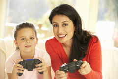 Mother And Daughter Playing Video Game At Home Stock Photo