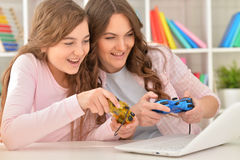 Mother and daughter playing video games Stock Image