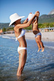 Mother and daughter playing in the water. Royalty Free Stock Image