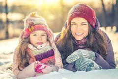 Mother and daughter playing in winter park royalty free stock photo