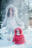 Mother and daughter playing on winter park Stock Images