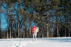 Mother and daughter playing on winter park Royalty Free Stock Images