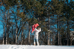 Mother and daughter playing on winter park Royalty Free Stock Photo