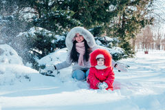 Mother and daughter playing on winter park Stock Photos