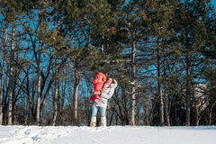 Mother and daughter playing on winter park Stock Photo