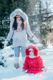 Mother and daughter playing on winter park Stock Image
