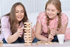 Mother and daughter playing with wooden blocks Royalty Free Stock Photos