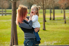 Mother and daughter playint together in park Stock Photo
