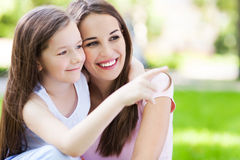 Mother and daughter pointing. Finger Royalty Free Stock Images