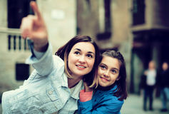 Mother and daughter pointing at sight during Royalty Free Stock Images