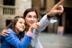 Mother and daughter pointing at sight during Stock Photos
