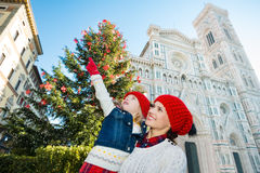 Mother and daughter pointing on something in Christmas Florence Stock Images