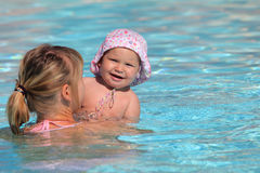 Mother with daughter in a pool Royalty Free Stock Image
