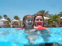 Mother with daughter in a pool. Mother with daughter in a swimming pool royalty free stock images