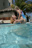 Mother and daughter in pool Royalty Free Stock Photography