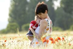 Mother and daughter in a poppy field Stock Photos