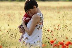 Mother and daughter in a poppy field Royalty Free Stock Images