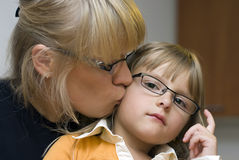 Mother and daughter portrait. Portrait of a mother and her daughter, both are wearing eyeglasses. Serious expression Stock Images