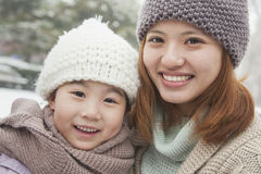 Mother and daughter portrait in winter Stock Photo