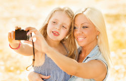 Mother and daughter pose for a self portrait Stock Images
