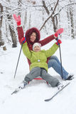 Mother, daughter pose on sled with skiing Royalty Free Stock Images