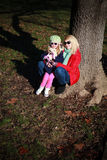 Mother and daughter posing in autumn park Royalty Free Stock Images