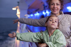 Mother daughter posing on board passenger ship Stock Photography