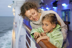 Mother daughter posing on board of ship Stock Images