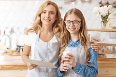 Mother and daughter posing in family cafeteria royalty free stock images