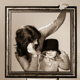 Mother and daughter posing with frame Stock Photos