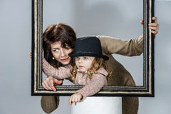 Mother and daughter posing with frame Royalty Free Stock Images